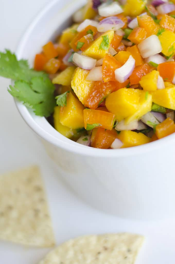 This Mango Salsa is a delightfully refreshing salsa that's balanced with sweet mango, zingy onions, and spicy jalapeno. Serve it as a unique chip dip, taco topper, or salad sprucer-upper!