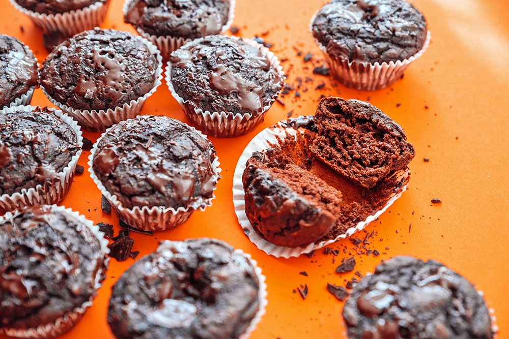 Chocolate cupcakes on an orange background