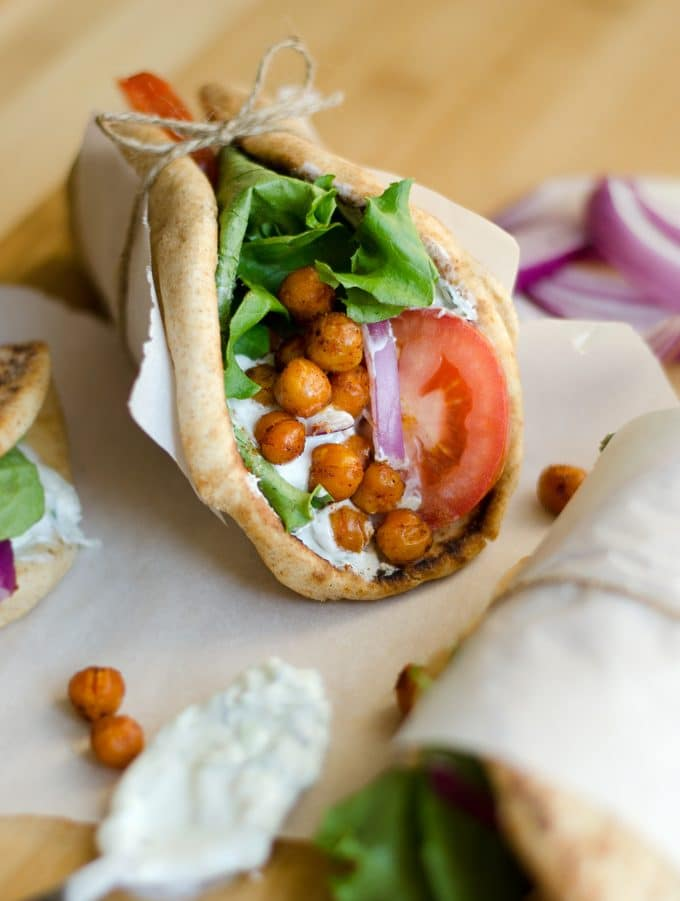 Roasted chickpea gyros with tomato and lettuce in a pita wrap
