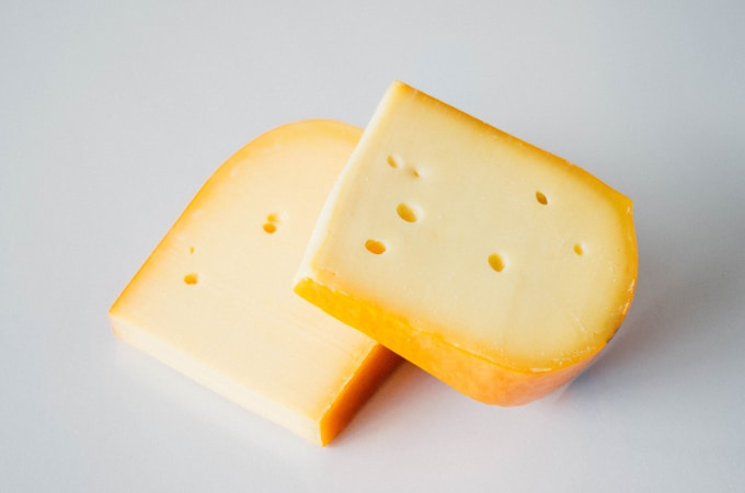 Block of Gouda cheese in the rind