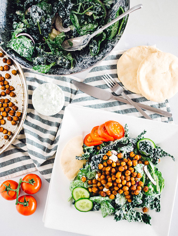 This kale salad is a healthy twist on Greek gyros that's packed with flavorful chickpeas and nutritious greens, and topped with a refreshing cucumber tzatziki sauce.