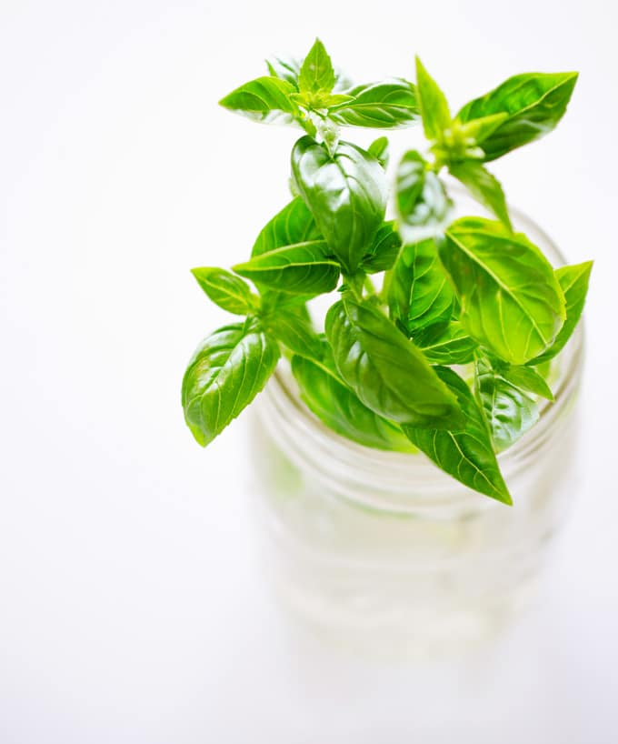 Store fresh basil leaves in glass of water