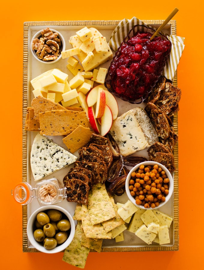 Vegetarian cheeseboard with cheese, crackers, fruit