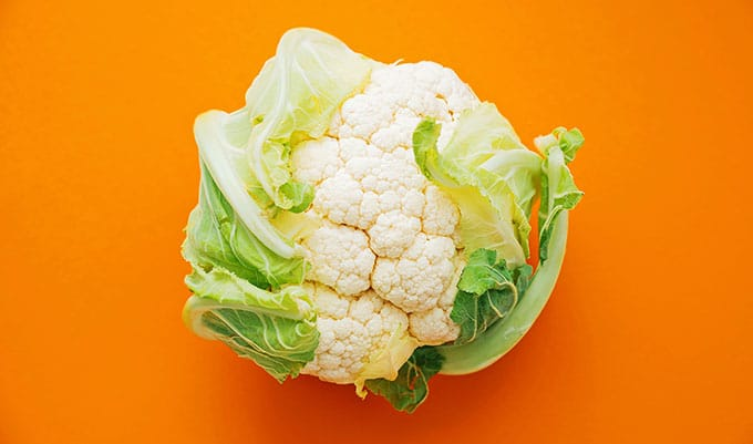 Cauliflower on an orange background