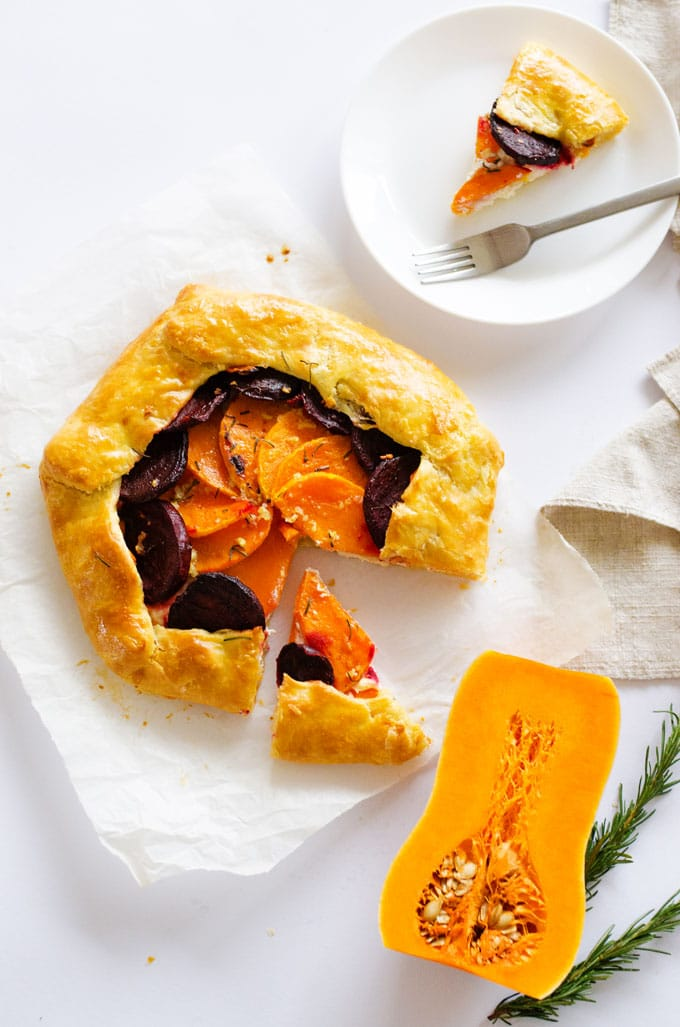 This Butternut Beet and Ricotta Savory Galette is layered with winter veggies and cheese, wrapped up in a flaky golden crust and sprinkled with rosemary.