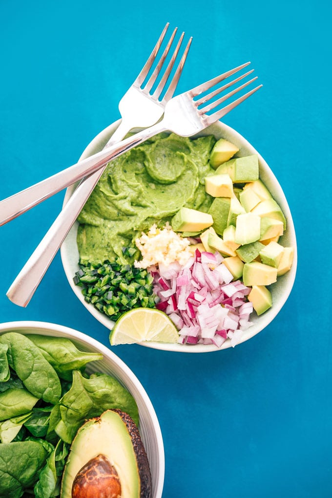 Ingredients to make guacamole in a bowl