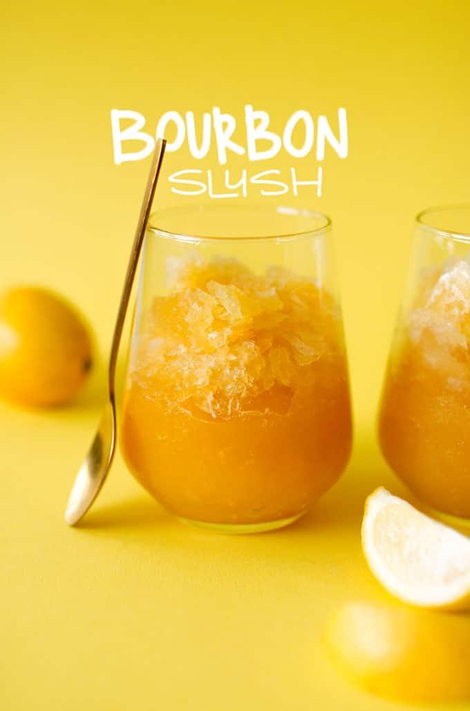 Bourbon slush in a glass on yellow background