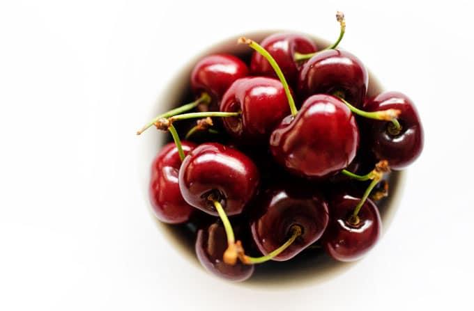 Bowl od cherries on white background