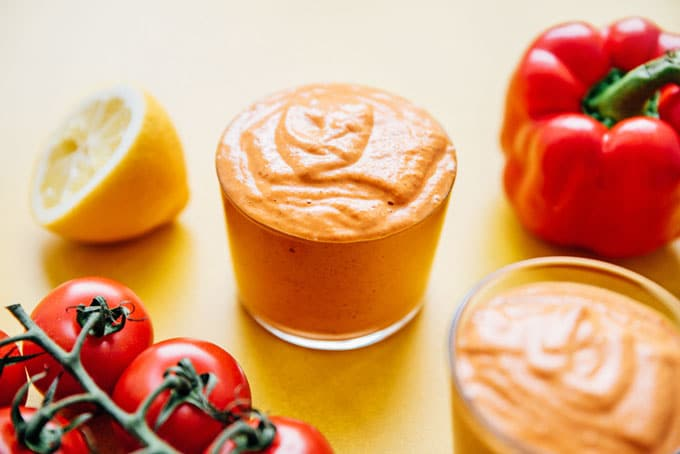 Romesco sauce recipe in a jar with tomatoes and red bell pepper