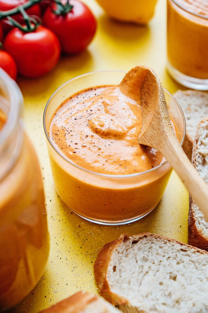 Romesco sauce recipe in a jar with a spoon