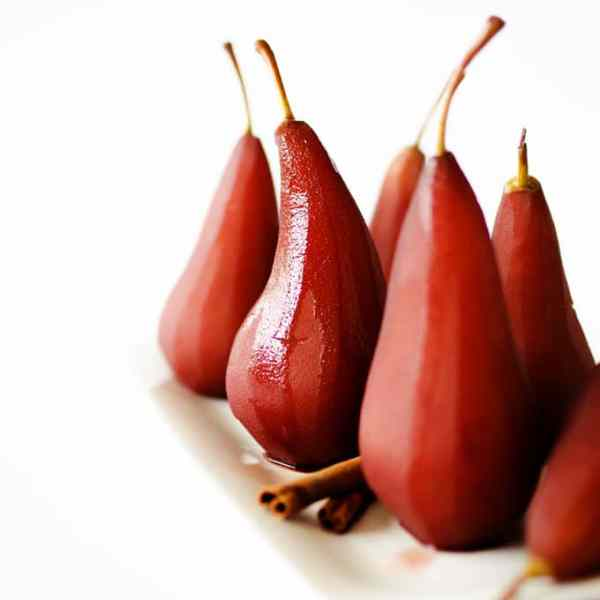 """These Dutch Poached Pears (or """"stoofpeertjes"""" as they call them here in the Netherlands) are a delicious wintertime classic. Just stew peeled pears in wine and spices for a half hour and serve!"""