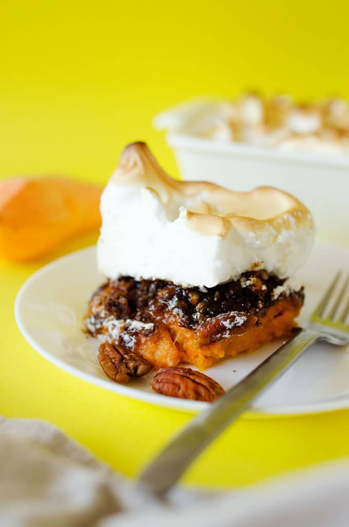 Slice of sweet potato casserole on a plate - This Sweet Potato Casserole with Pecan Crumble and Meringue is the ultimate Thanksgiving side dish. It's crunchy, creamy, and so addictive.