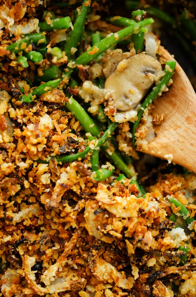 Close-up of vegan Green Bean Casserole in a cast iron skillet - A healthy twist on a classic Thanksgiving staple...Vegan Green Bean Casserole with crispy panfried onions!