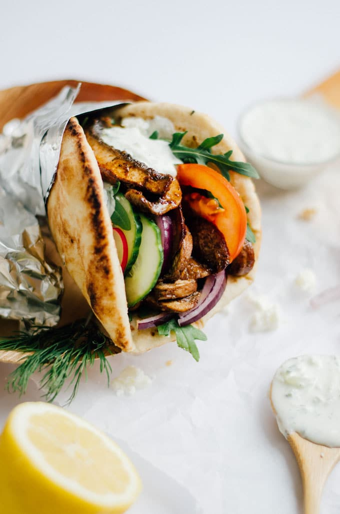 These vegetarian Portobello Mushroom Gyros are seasoned with a flavorful blend of Mediterranean spices and grilled to meaty perfection, then drizzled with a quick homemade feta tzatziki and wrapped in pillowy pita (oh, and all in under 15 minutes).