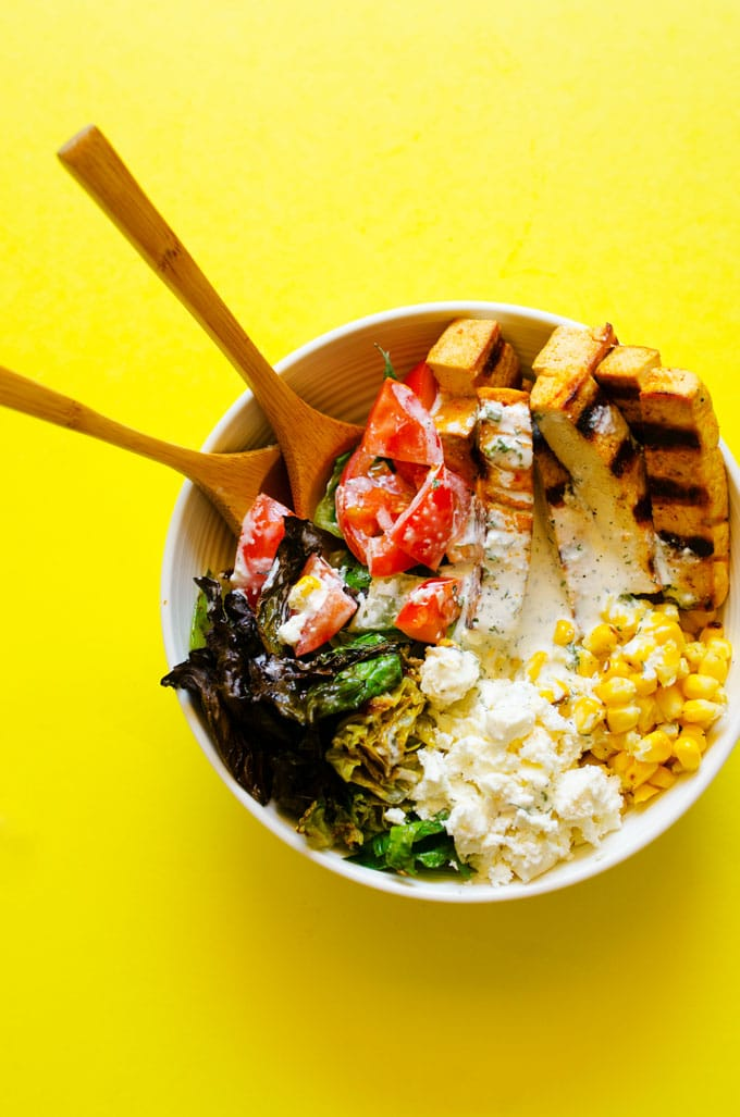 With crispy tofu, grilled corn, and your favorite summer salad toppings, this vegetarian Grilled Romaine Salad is turning out-of-the-ordinary into your new weekly dinner ritual.