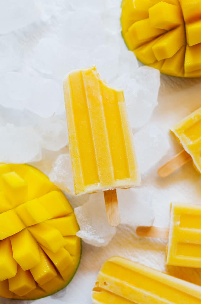 These Mango Lassi Popsicles have it all...the sweet mango, the soft texture, the...kefir? Packed with probiotics and ultra-creamy, kefir is the secret to these refreshing summer pops.