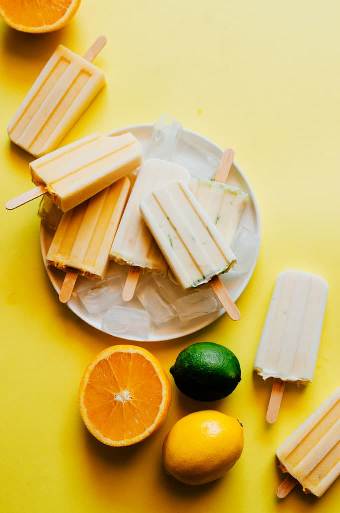 Showing you how to make not one, not two, but THREE creamsicle popsicles today, from lemon and lime to classic orange creamsicles (with a tropical mango twist).