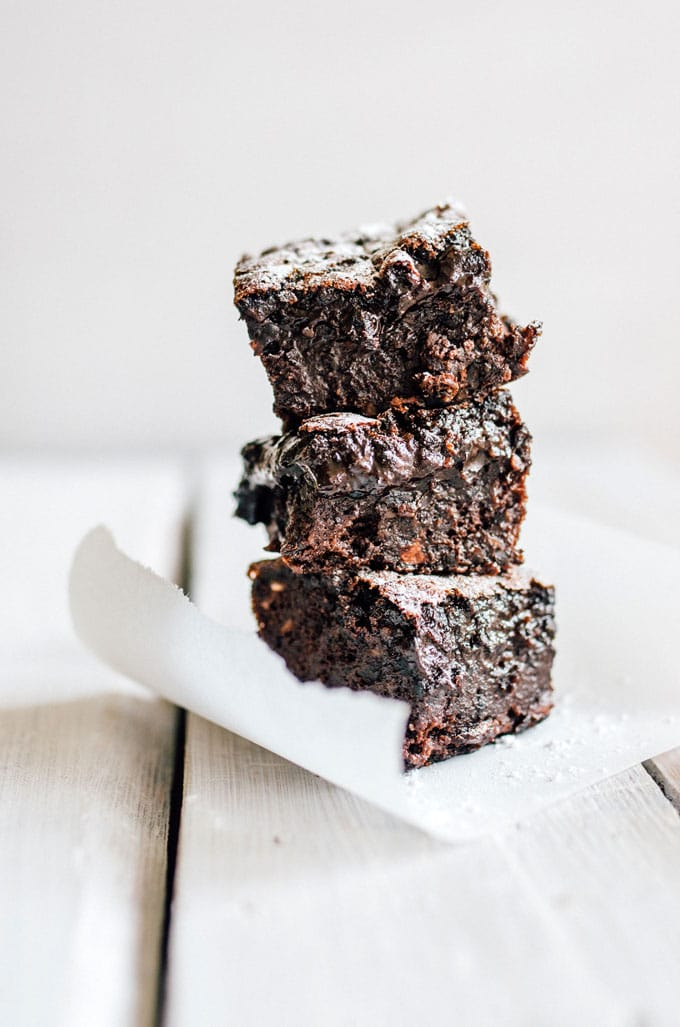 These Fudgy Black Bean Brownies are a decadent gluten-free dessert (and no one will ever guess that they're packed with fiber-filled black beans!)