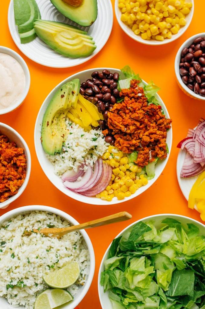 A flavor packed (and easy to make) vegan burrito bowl with tempeh taco meat and copycat Chipotle cauliflower rice!