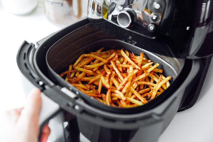 French fry potatoes in an air fryer - The ultimate guide on how to cook air fryer potatoes! How to make roasted potatoes, homemade French fries, and potato chips in your air fryer, using both white potatoes and sweet potatoes.