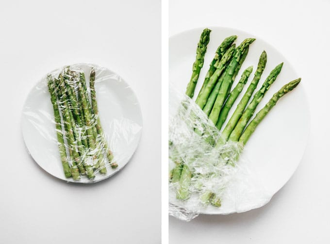 Microwaved asparagus recipe on white background - The ultimate guide on how to cook asparagus! How to cook asparagus in the oven, in the microwave, or by blanching, steaming, or sautéing.