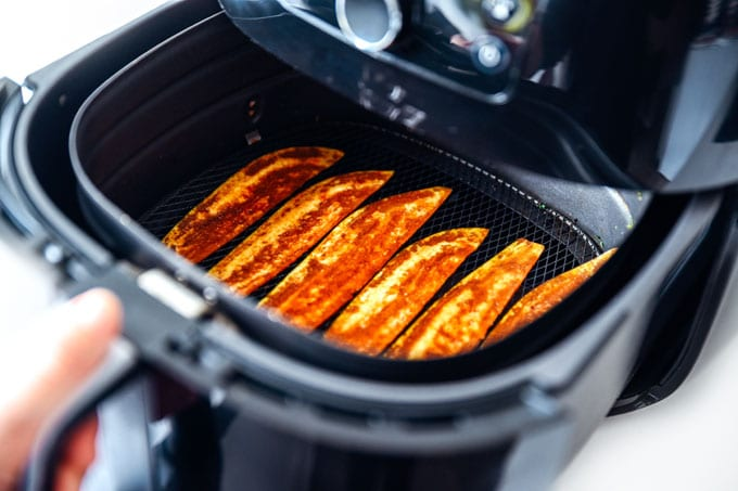 Vegan eggplant bacon recipe on in air fryer - This vegan Eggplant Bacon recipe takes all the flavor and crispiness of bacon and packs it into thinly sliced bacon!