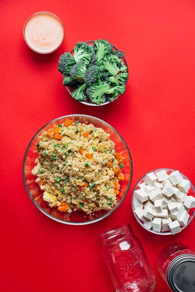 Vegetarian stir fry meal prep idea ingredients on a red background