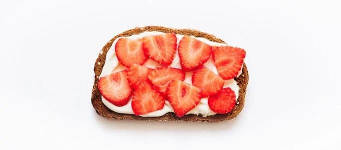 Healthy toast with greek yogurt and strawberries