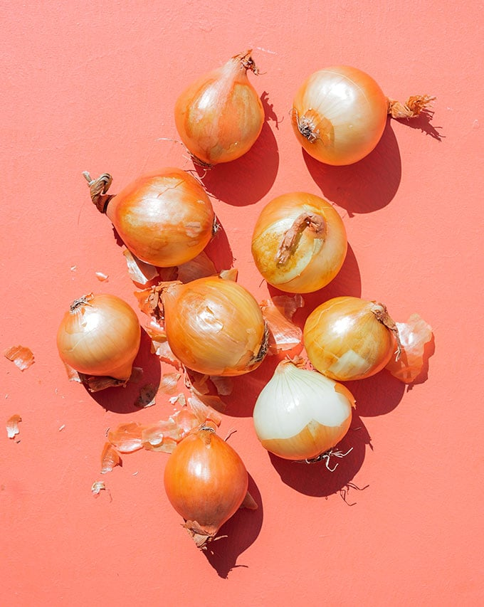 White onions on pink background