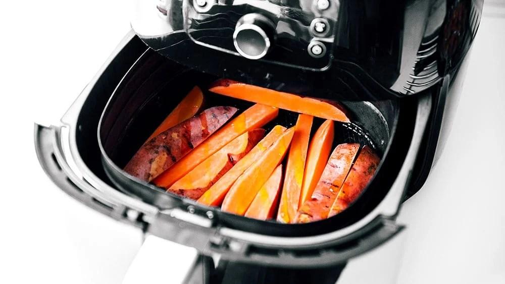 Cooking sweet potato fries in an air fryer basket