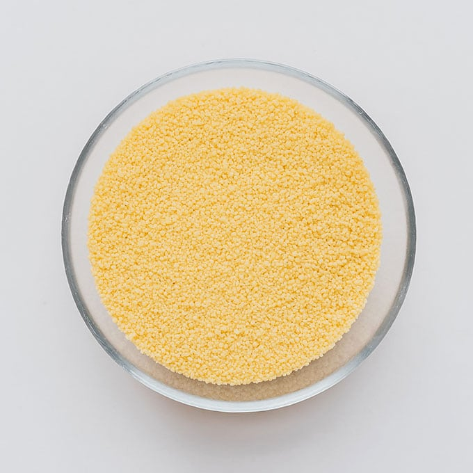 Couscous in a bowl on a white background
