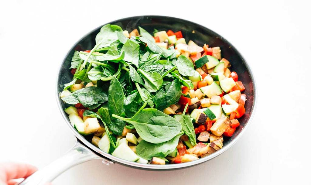 Mixed vegetables in a pan on a white background