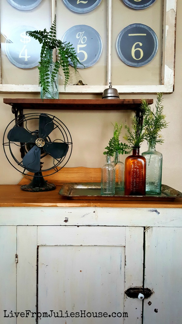 Old Window Upcycle + Budget Friendly Living Room Update - I was looking for something unique to put in my old window, so I picked up a couple items at Hobby Lobby, added a few things I had around the house and managed to update this little corner of my living room for just $19