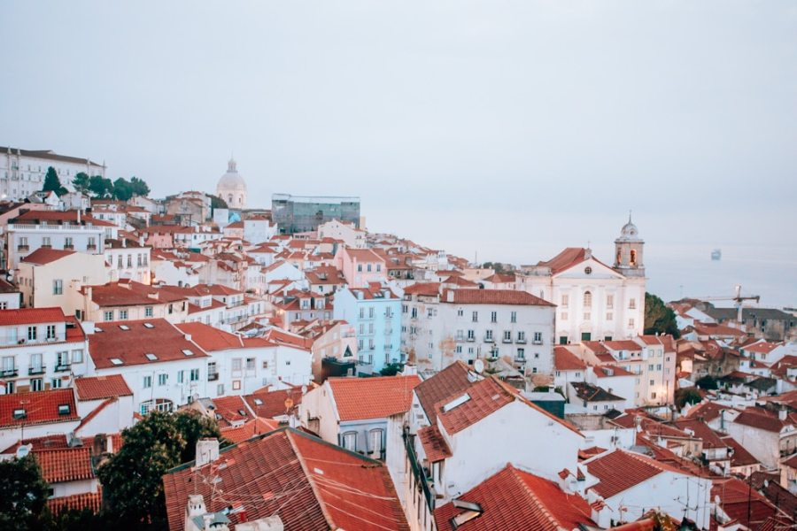 View of Lisbon from Alfama. Find the best places in Lisbon for Instagrammable photos and when to go to get them to yourself!