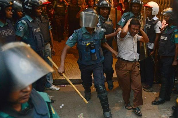 Bangladeshi police detain a supporter of the opposition Bangladesh Nationalist Party during a protest in Dhaka. Photo: AFP