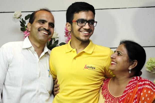 IIT JEE topper Sarvesh Mehtani with his parents in Chandigarh on Sunday. Photo: Keshav Singh/HT
