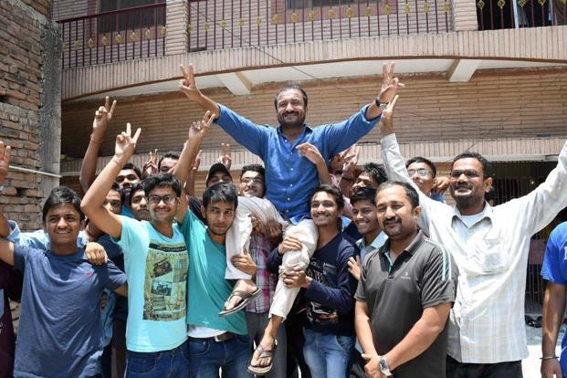 Super 30 founder Anand Kumar celebrates the success of his students who cracked IIT JEE (Advanced) examination, in Patna on Sunday. Photo: PTI
