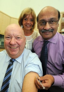 Mayor Joe Anderson receives his jab from Dr Nadim Fazlani, Chair of Liverpool CCG and Liverpool's director of public health, Dr Paula Grey