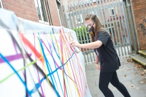 Alsop High School Year 10 pupil Alex Birkett works on artwork for the Mark It Festival