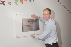 Paul Galloway Morgan Sindall hangs the time capsule plaque