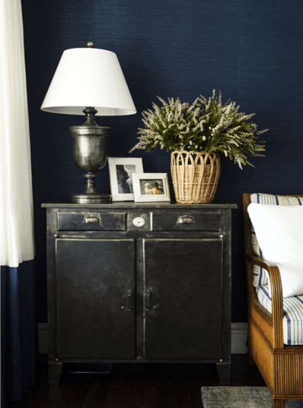 Navy grasscloth, awesome lamp, and matching navy curtain trim.