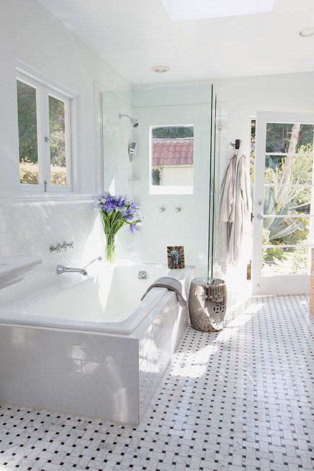 Gorgeous bathroom with basketweave tile and tons of light.