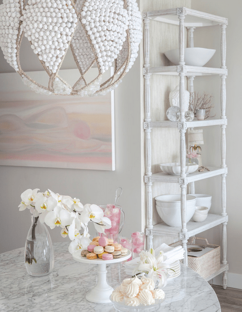 Design magic from Peridot Decorative Homewear: soft, white, with subtle hints of sophistication and the beach. How'd they do that?!