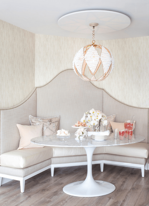 Banquette, marble table, and the most beautiful light fixture from Peridot Decorative Homewear.