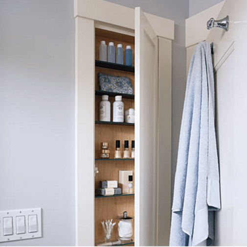 This is a genius idea for small spaces--take advantage of the potential storage space behind the door!