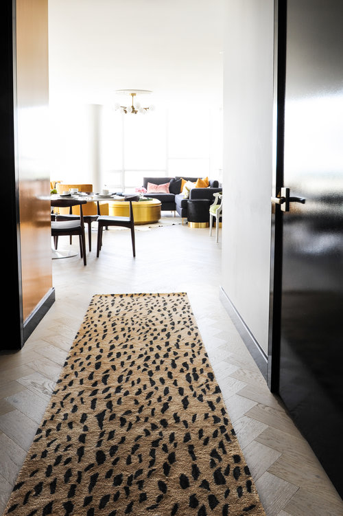 Retro gets reimagined in this crazy stylish home. Case in point: the leopard (-ish) print runner.