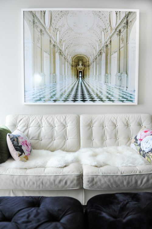 White leather done right! Love this classic white leather sofa with David Burdeny dramatic print of Reggia di Venaria Reale.