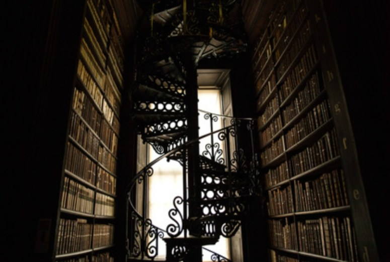My favorite books of all time surrounded by an ornate spiral staircase