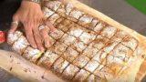 Συνταγή για Μπουγάτσα με πλούσια κρέμα και πασπαλισμένη με άφθονη άχνη ζάχαρη και κανέλα!