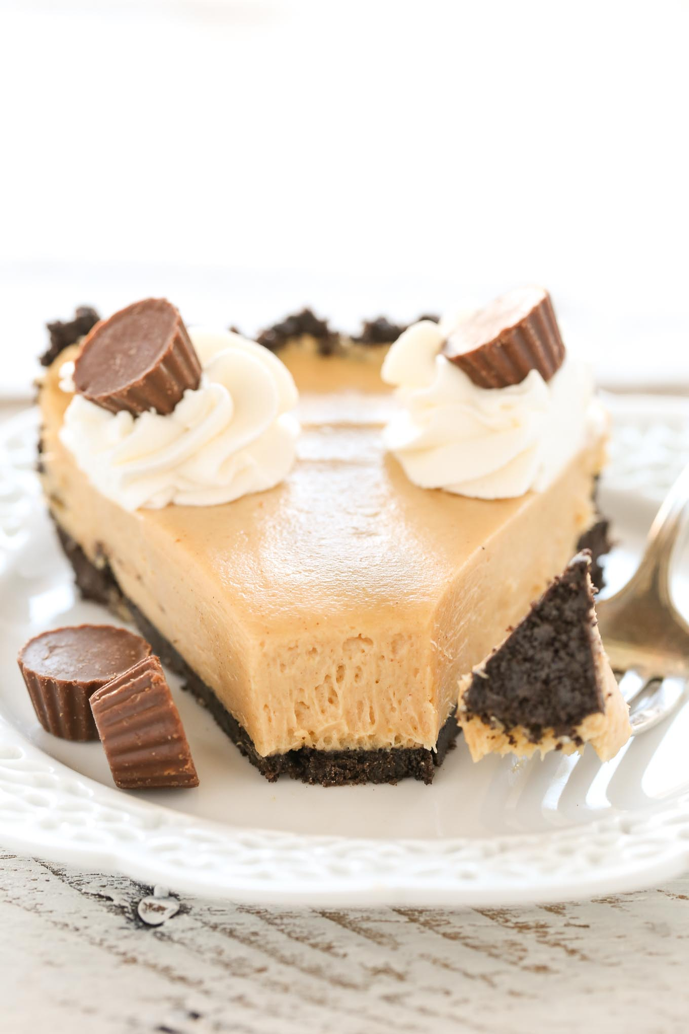 An easy no-bake peanut butter pie on top of a homemade Oreo crust.  The perfect pie to enjoy year-round!